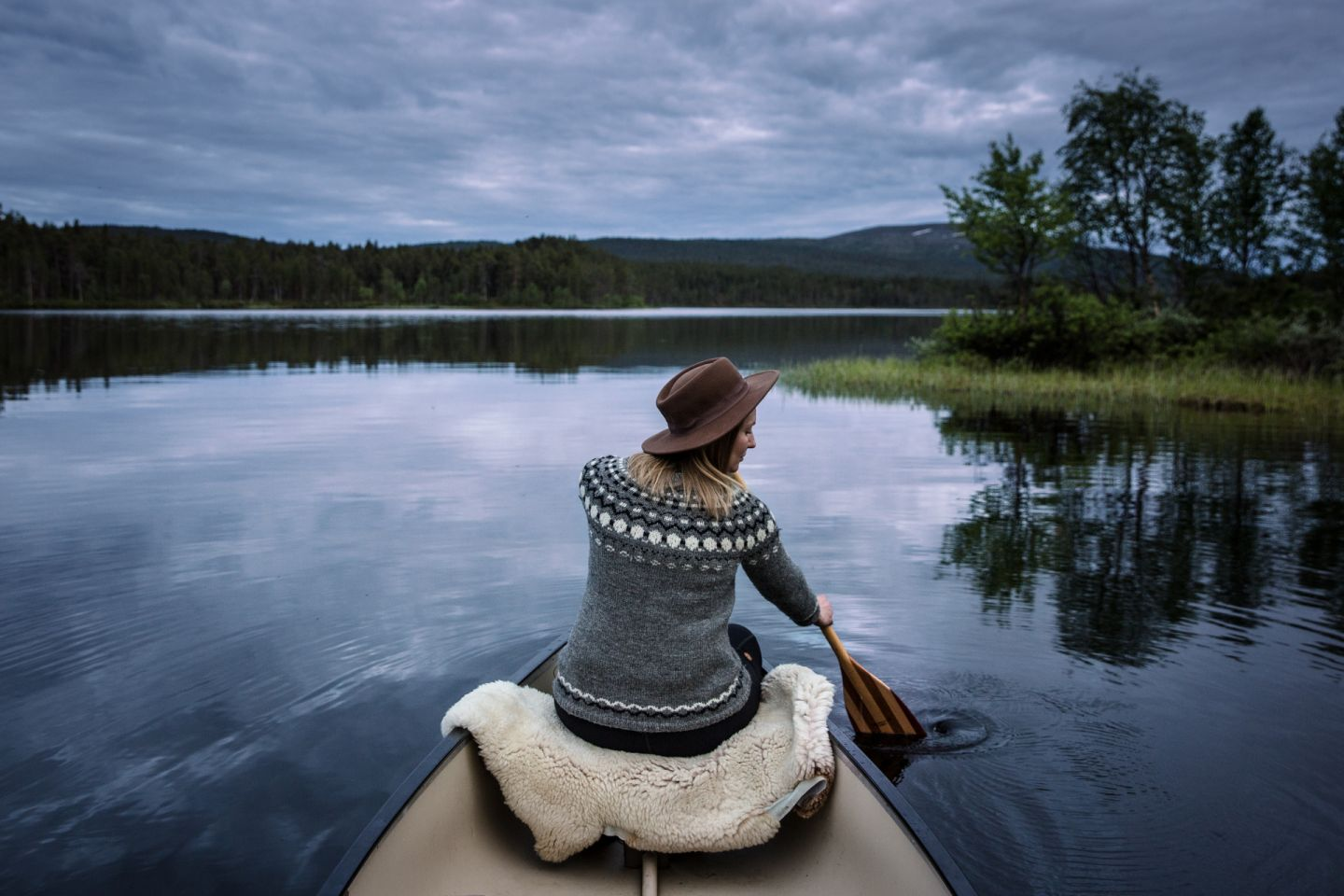 Canoeing in the calm waters of Finnish Lapland