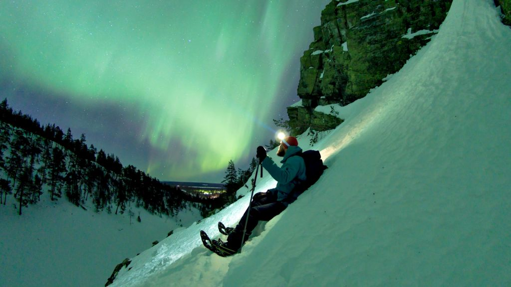 Watching the Northern Lights on a hillside in Finnish Lapland
