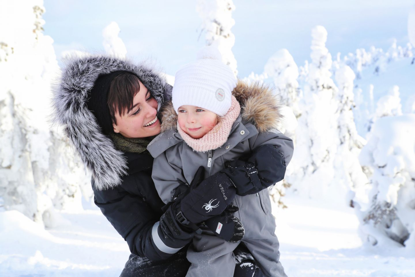 A family enjoying the winter in Finnish Lapland