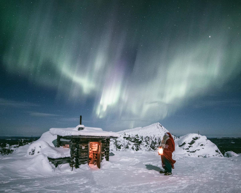 Santa enjoys auroras over Mt. Korvatunturi in Savukoski, Finland