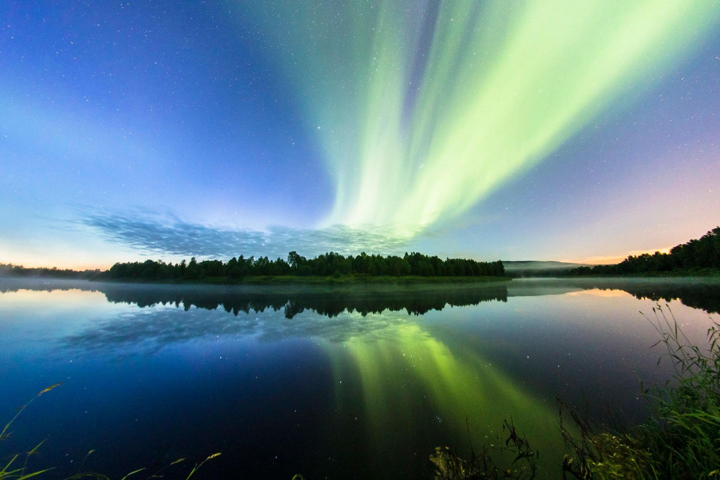 Northern Lights over the waters of Lapland, Europe's last wilderness