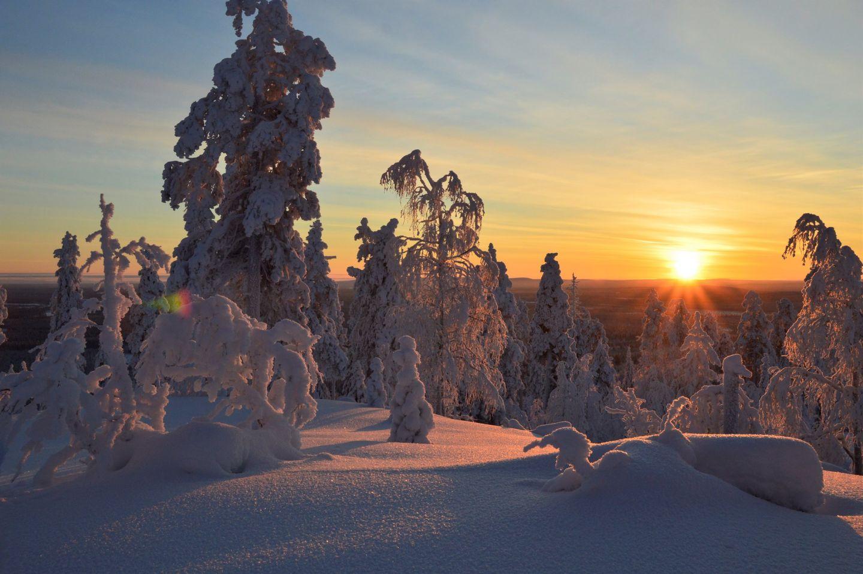 A winter sunset in the Arctic wilderness of Savukoski, Finland