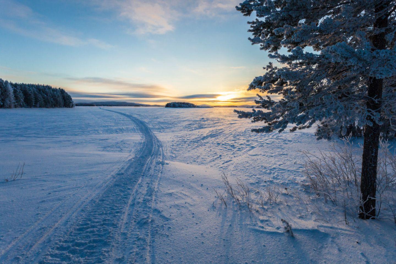 A snowmobile path across Lake Kemijärvi on the Arctic Circle