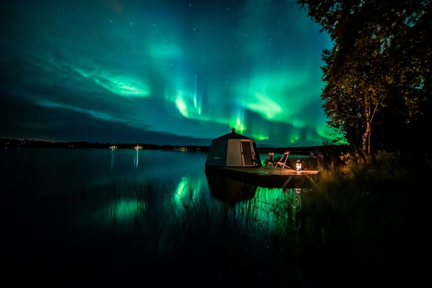 The auroras over a floating igloo in Ranua, Finland