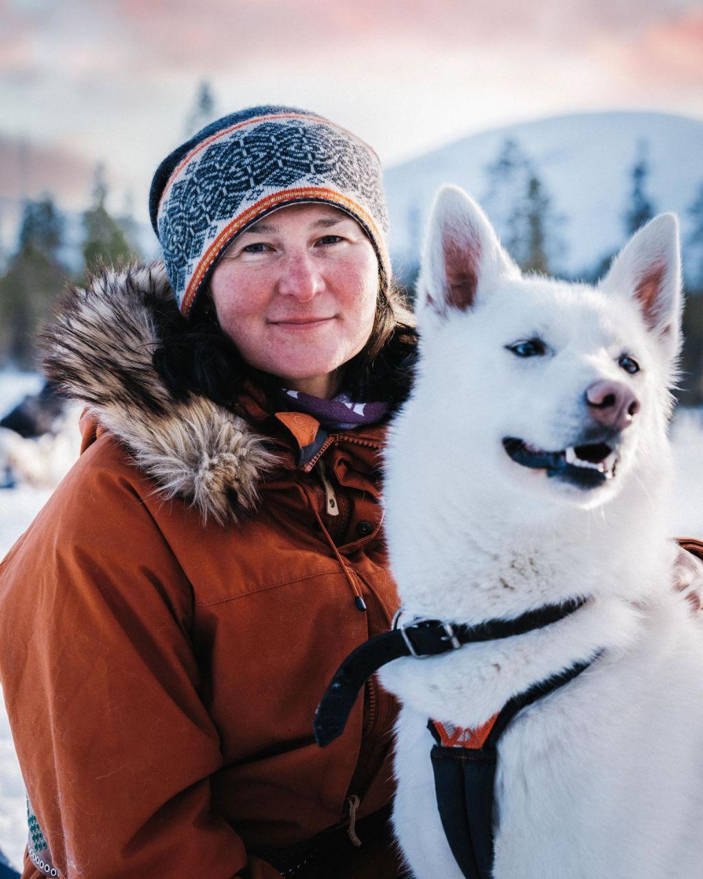 Aksana Kurola, entrepreneur of Yoga Nature, with her husky dog