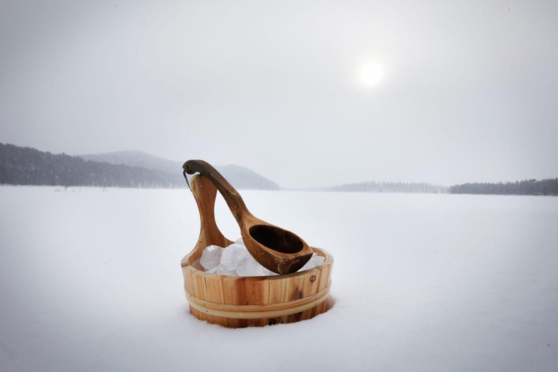 A sauna bucket in the snow in Ruka, Finland