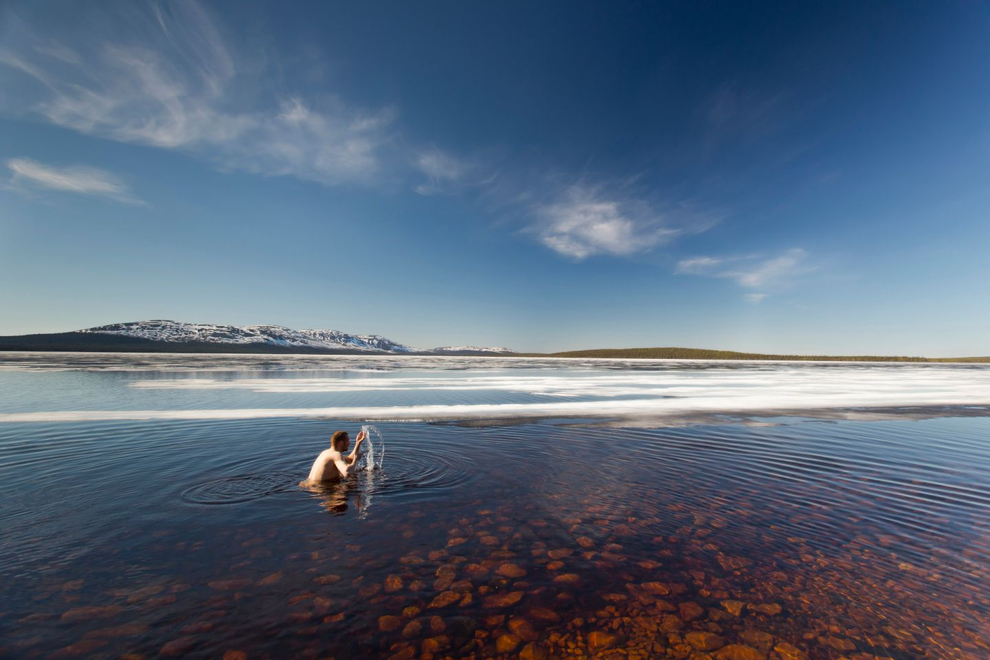 Going for a spring swim in Finnish Lapland