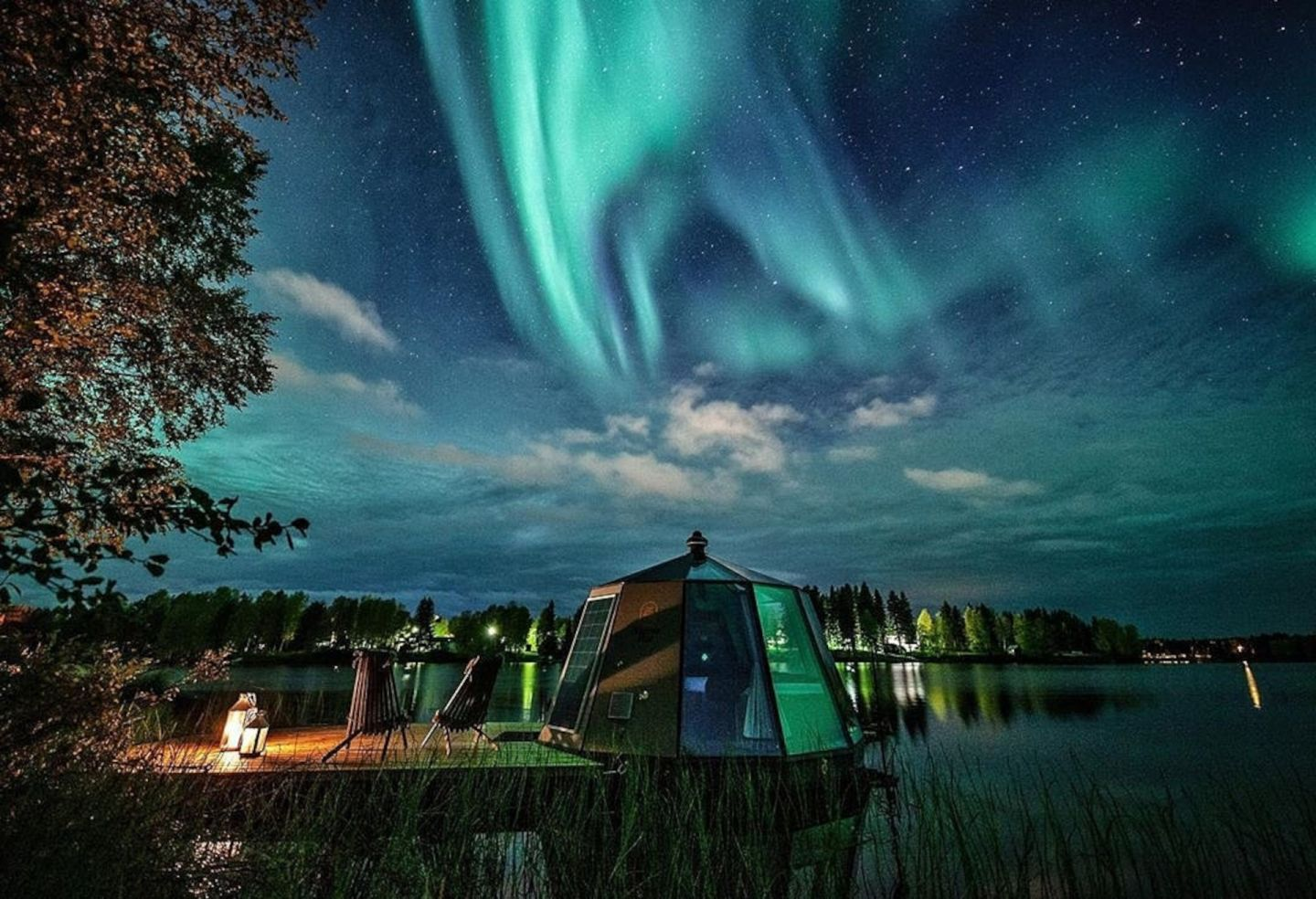 Northern Lights over floating igloos in Ranua, Finland