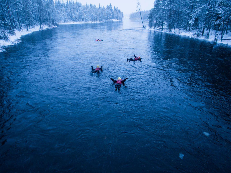 Floating on the river in winter in Ruka-Kuusamo, Finland