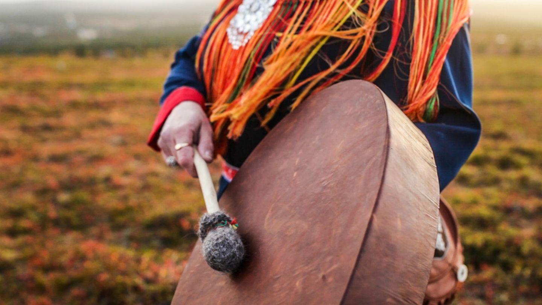 A Sámi banging a drum in Inari, Finland