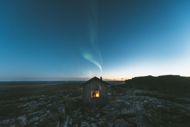 Auroras over a wilderness hut in Pyhä-Nattanen in Sompio, Finland