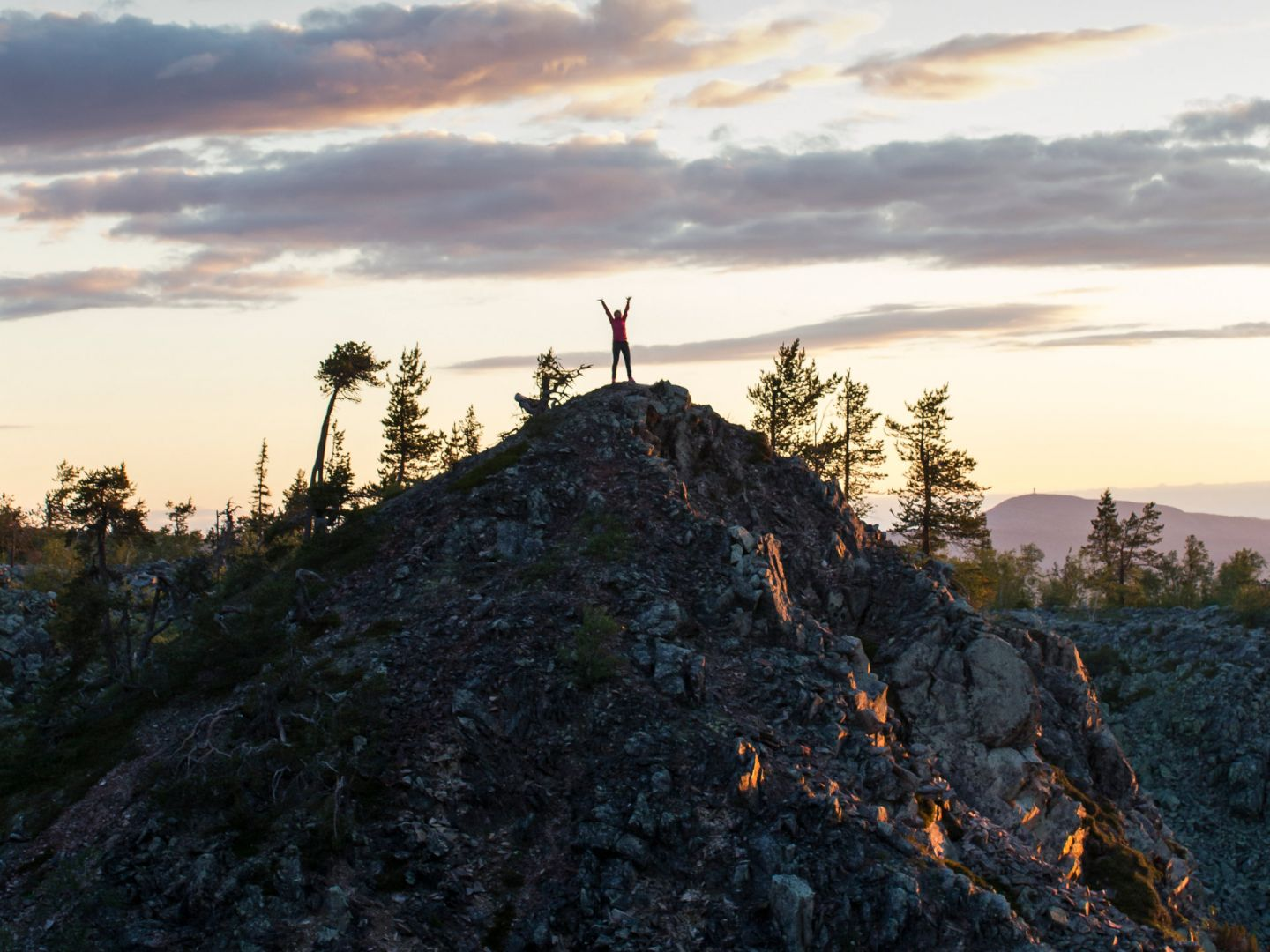 Climbing a fell during a slow travel trip to Finnish Lapland in the summer