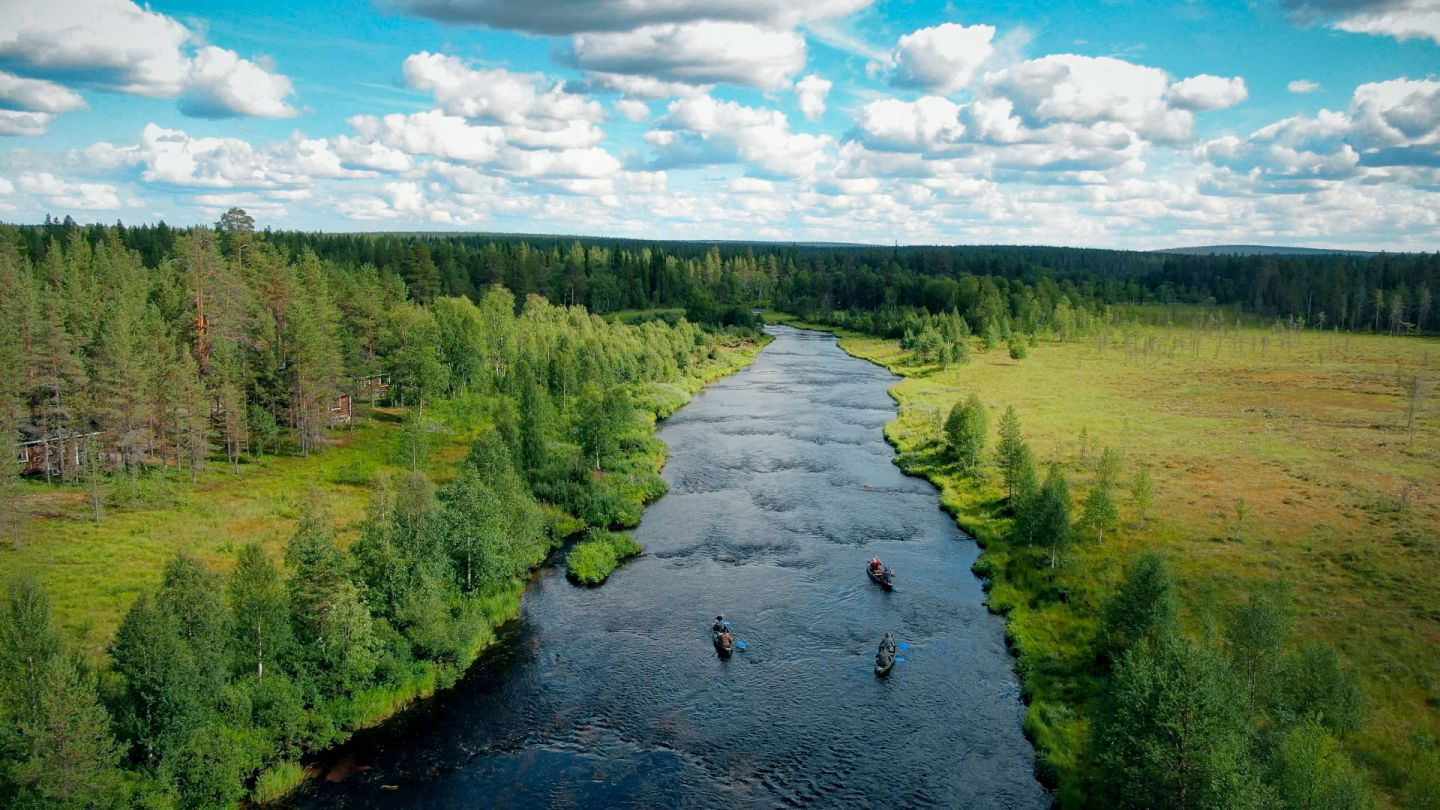 Paddling up a river during a slow travel trip to Finnish Lapland in the summer