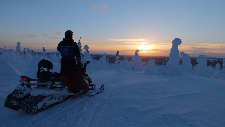 Snowmobiling in Salla, Finland in winter