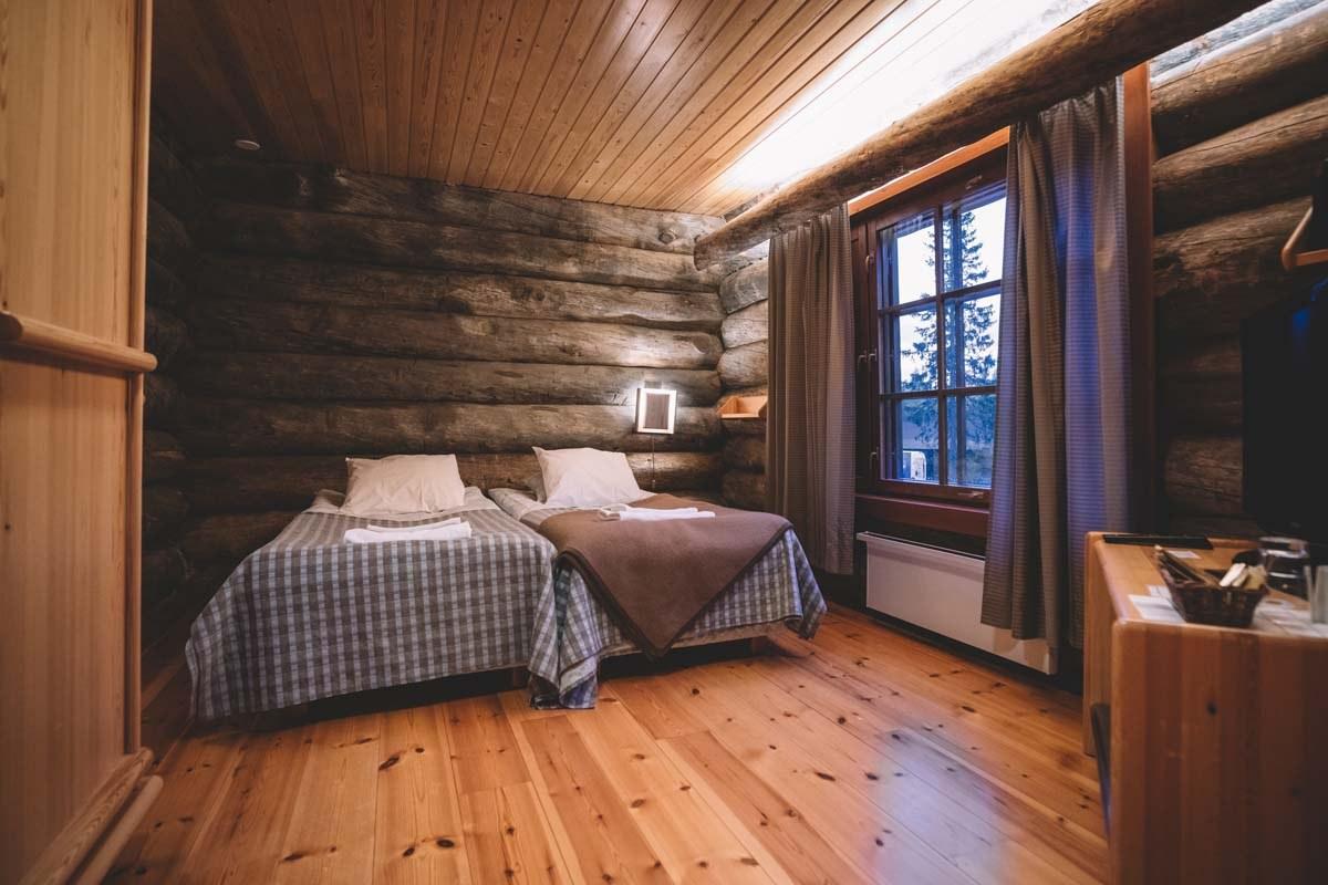 A log cabin room at Santa's Log Villa Borealis, a special winter accommodation in Luosto, Finland