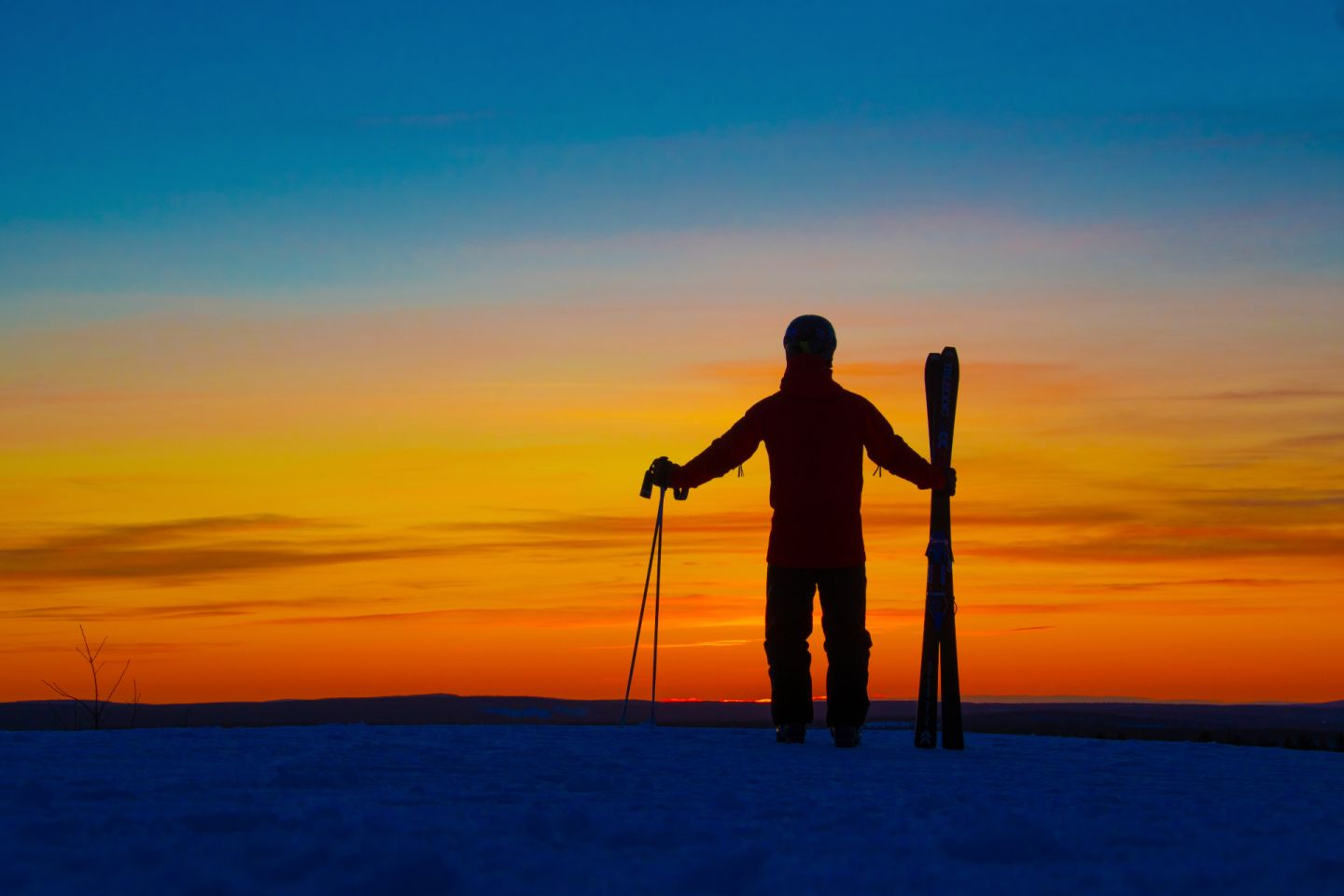 Enjoying an early sunset on a ski slope in Rovaniemi, Finland in winter