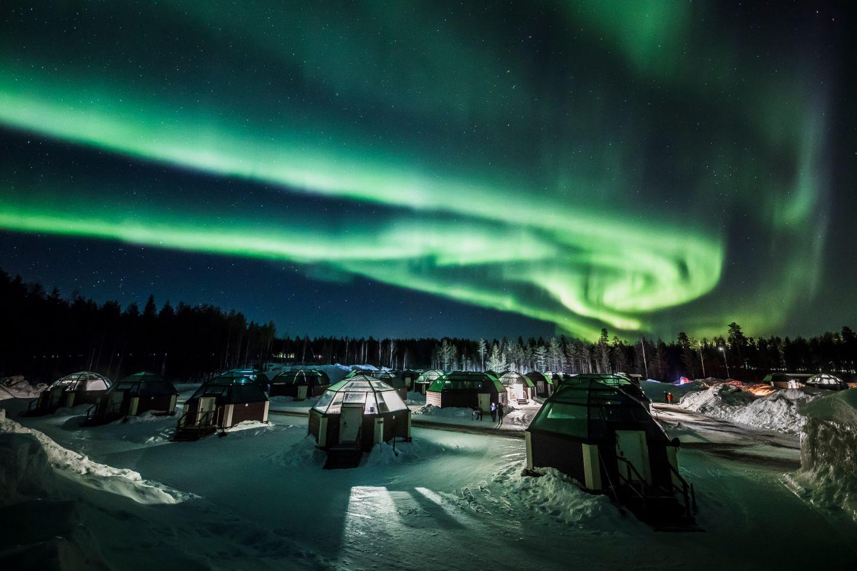 Auroras over igloos in Rovaniemi, Finland
