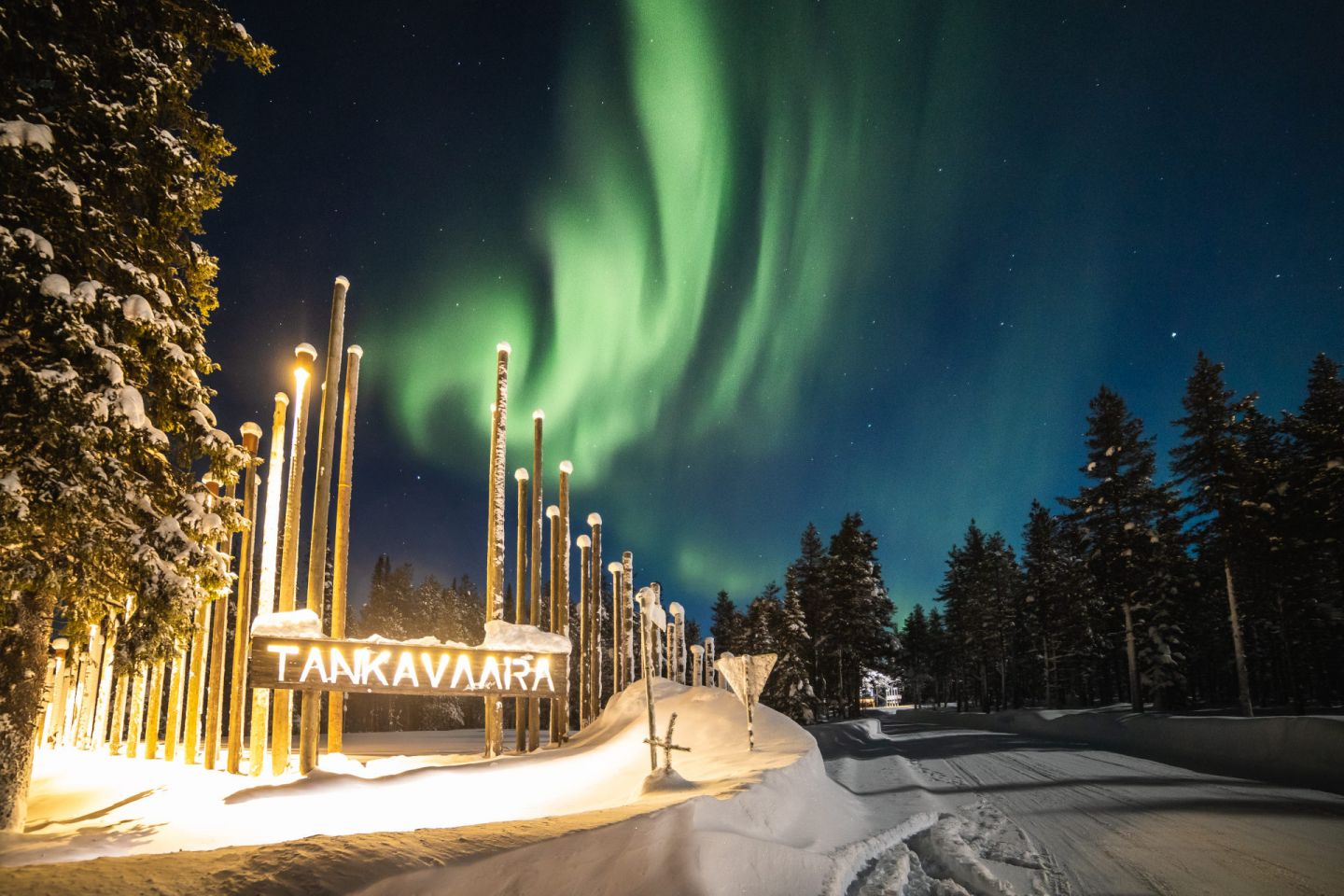 Northern Lights over Tankavaara Gold Village, a special winter accommodation in Sompio, Finland