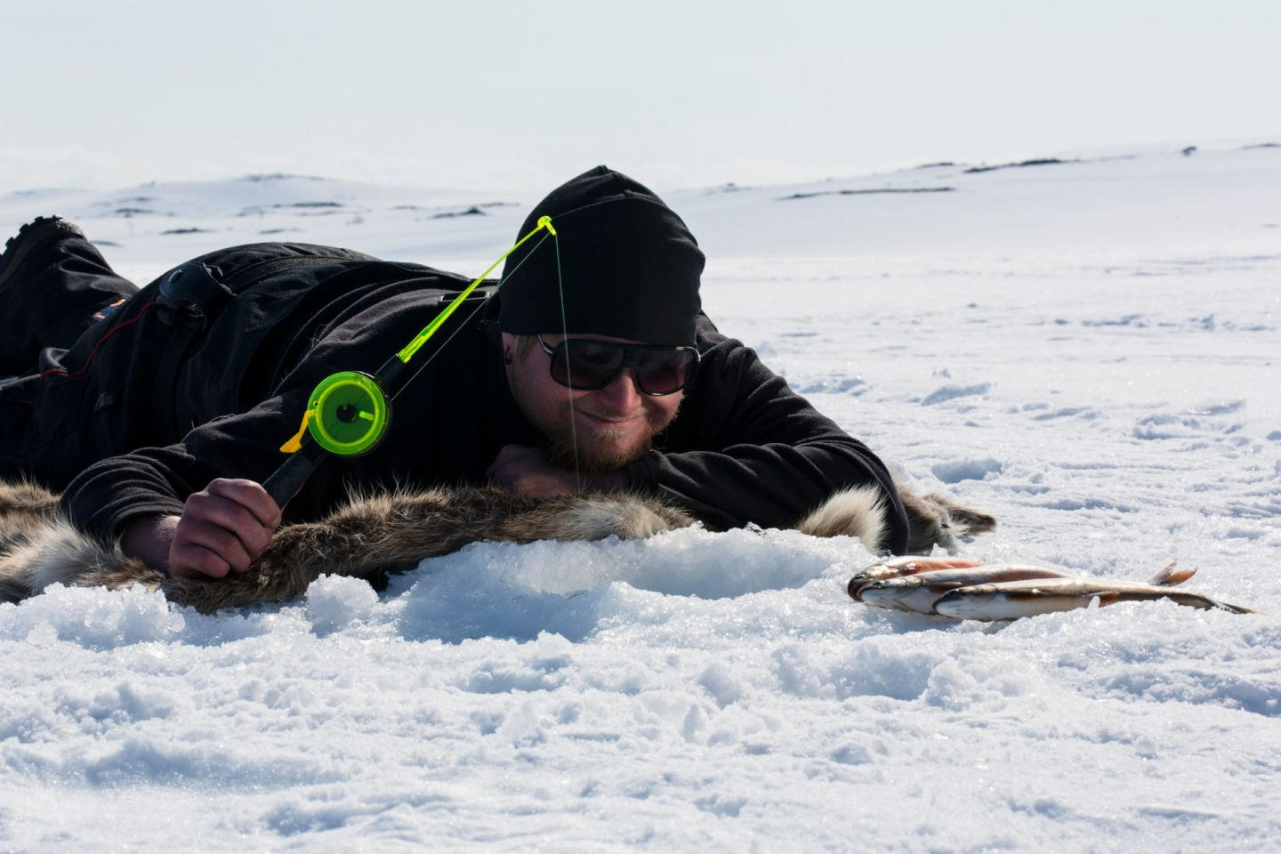 Ice-fishing in Nuorgam, Finland in winter