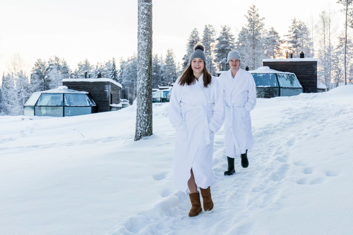 On the way to the sauna at Arctic Fox Igloos, a special winter accommodation in Ranua, Finland