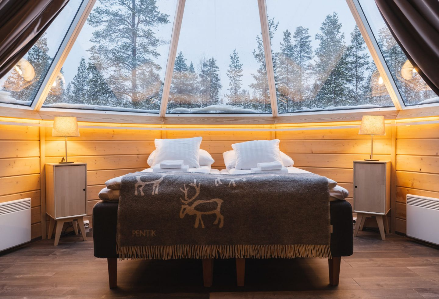 The view from the bed at Northern Lights Village, a special winter accommodation in Inari-Saariselkä, Finland