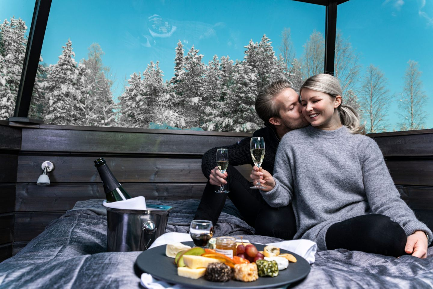 A romantic evening together in an aurora bubble in Rovaniemi, Finland in winter