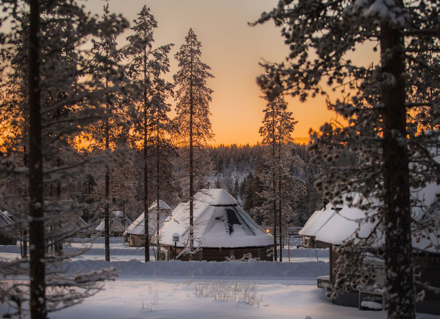 Sunset at Northern Lights Village, a special winter accommodation in Saariselkä, Finland