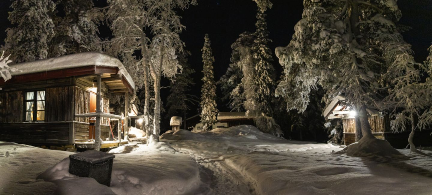 A snowy night at Tankavaara Gold Village, a special winter accommodation in Sompio, Finland