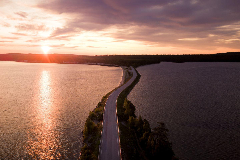 Road under the Midnight Sun in Posio, Lapland, Finland